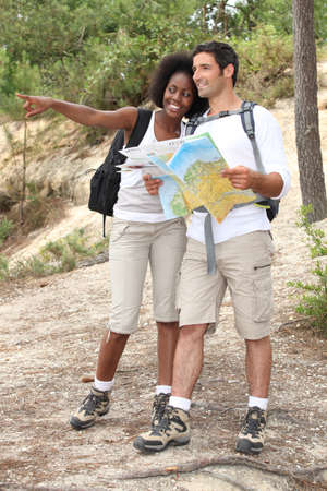 Couple hiking with a map photo