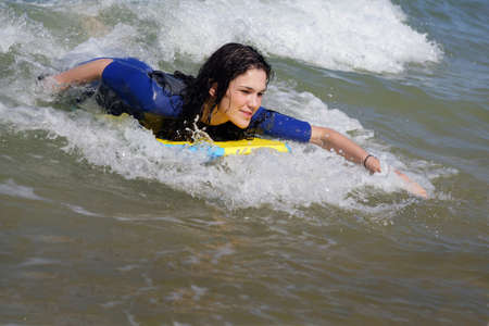 Woman bodyboarding photo