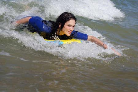 boogie: Woman bodyboarding Stock Photo