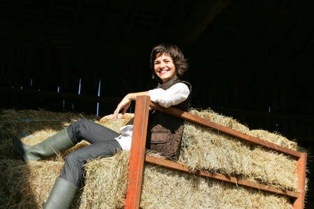 Woman sat on hay bales Stock Photo - 12006528