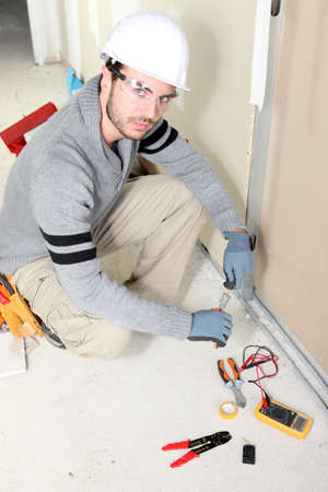 Electrician installing wiring photo