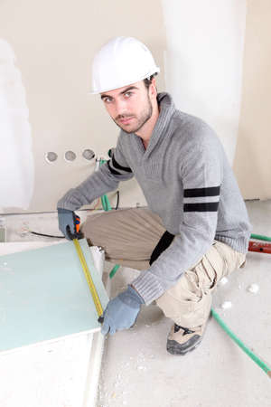 Laborer in room under construction photo