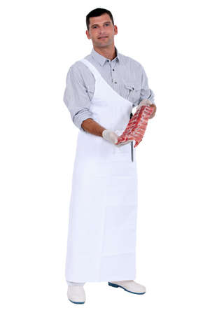 butcher with piece of meat photo