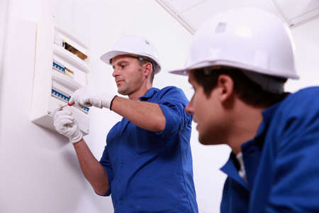repairmen: Electricians working Stock Photo