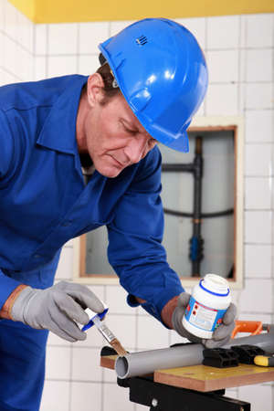 laboring: Skilled technician repairing canalizations Stock Photo
