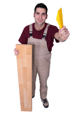 jumpsuite: carpenter posing with floorboards and a float