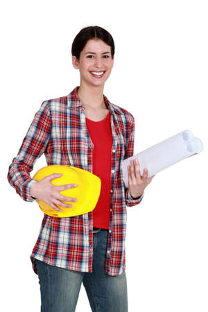 craftswoman holding a helmet and a blueprint Stock Photo - 12019399
