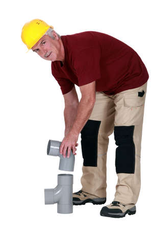 plunger: Plumber connecting two parts Stock Photo