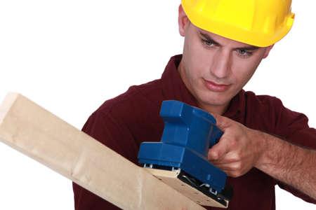 sander: Worker with an electric sander