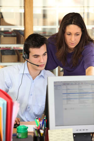 Teleoperator working in a call center Stock Photo - 12019233