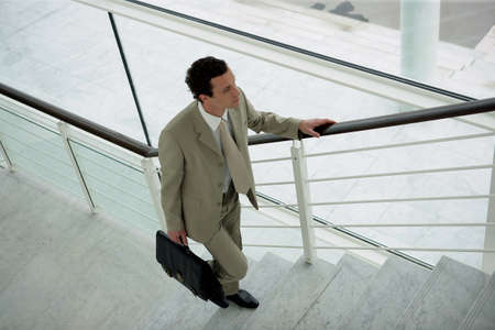 steps to success: businessman climbing the stairs