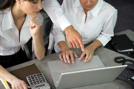 Businesspeople working together on a project photo