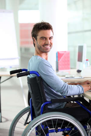 accessible: Young man smiling in wheelchair