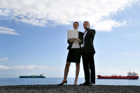 Business couple in front of tankers photo