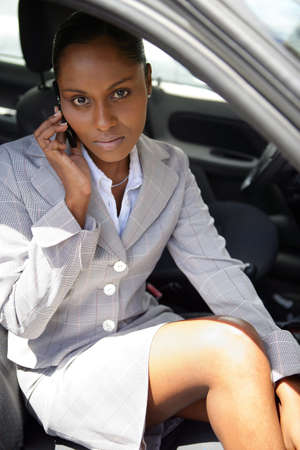 african woman face: businesswoman in a car talking on her cell