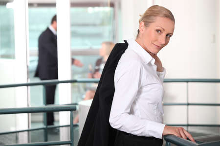 leaving: portrait of a businesswoman in a hall Stock Photo