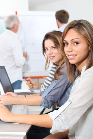 Young women smiling in classroom Stock Photo - 12019434