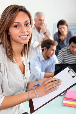 woman with notepad in classroom Stock Photo - 12019604