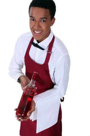 Waiter with bottle of rose wine photo