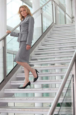 Businesswoman walking down steps photo