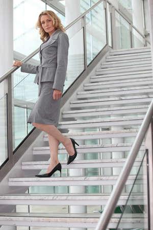 walking down: Businesswoman walking down steps