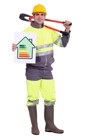 Tradesman holding large clippers and an energy efficiency rating chart photo