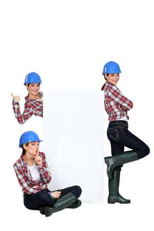 unbiased: female trio wearing blue hard hat looking joyful