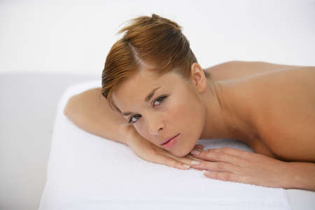 Woman laying down waiting for massage photo
