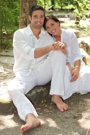 Couple relaxing outside Stock Photo - 12019624