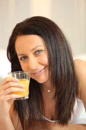 bedraggled: Woman with a glass of orange juice