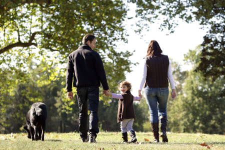 Family walking their dog Stock Photo