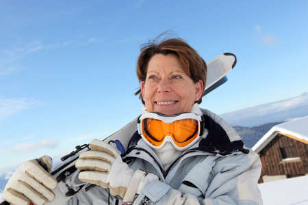 lodge: Older woman skier outside a chalet