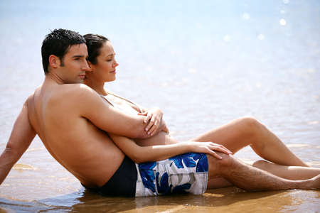 courtship: couple hugging at the Oceanside