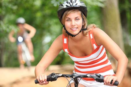 Teenage girl on a mountain bike photo