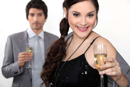 Man and woman drinking champagne for a celebration Stock Photo - 12019418