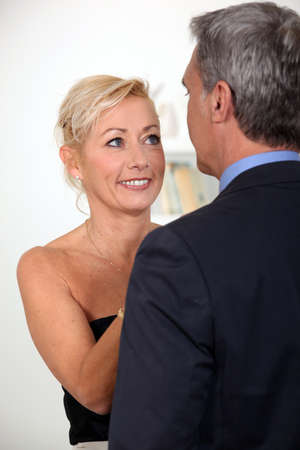 45 years old: Tell me darling. Stock Photo