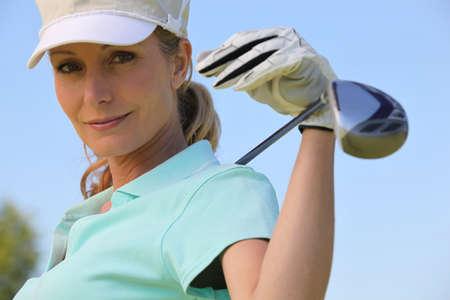 golf cap: A portrait of a female golfer. Stock Photo