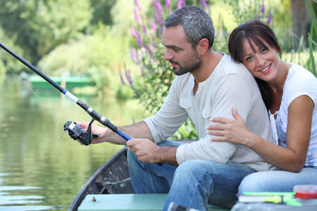 Couple fishing on a river photo