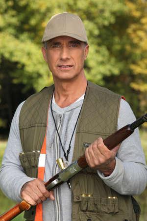 cap hunting dog: Portrait of a hunter
