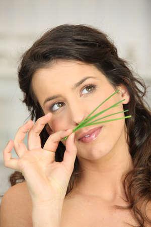 olfaction: Woman smellinggrass