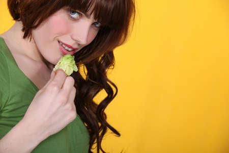Woman eating iceberg lettuce Stock Photo - 12019296