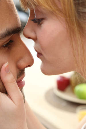 Young couple kissing tenderly photo