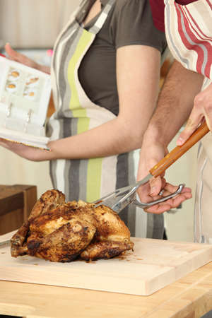 Man cutting chicken on a cutting board Stock Photo - 12019607