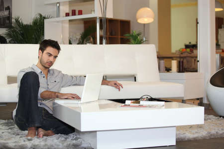 Attractive man using a laptop photo