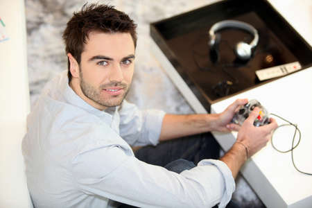 Man using computer console photo