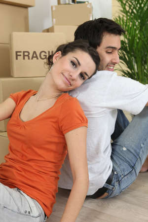 Couple relaxing after hard day moving house photo