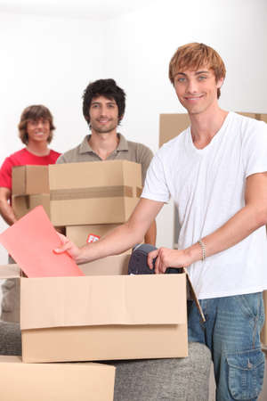 Three men moving house Stock Photo - 12019467