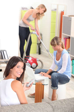 Cleaning team: Three female housemates cleaning