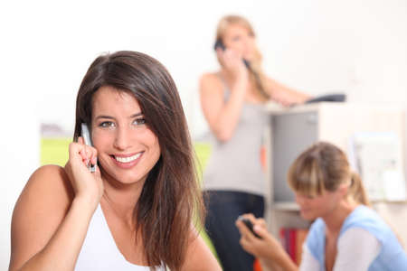 roommates: Attractive woman talking on her mobile phone