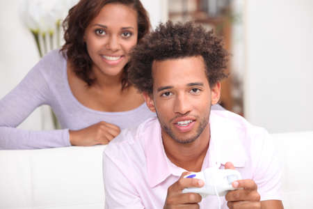 captivate: Woman looking at her boyfriend playing video games